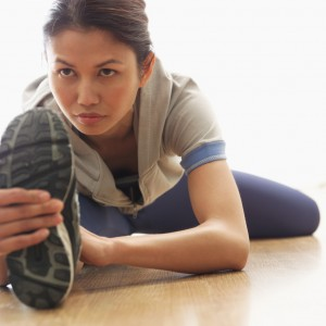 Woman Stretching Before Exercising